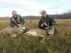 Bill Strawberry (left) with a 4x4 mule and Art with a 146 2/8 4x4 whitetail.